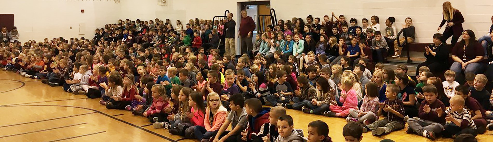 Students attending the Holiday Assembly.