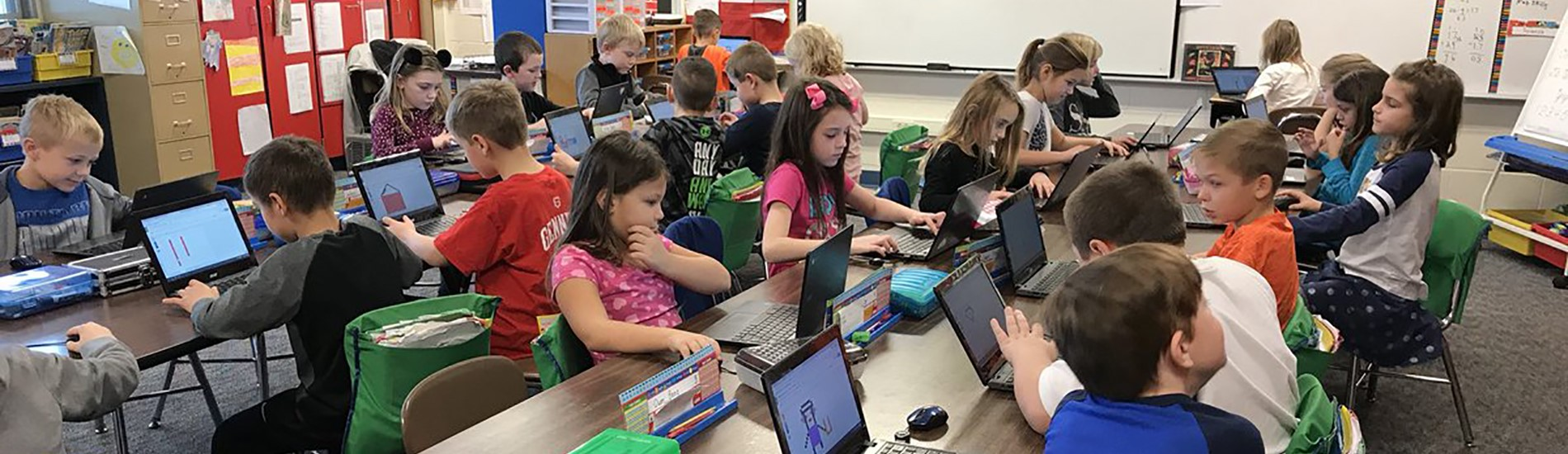 Students using Chromebooks to create.