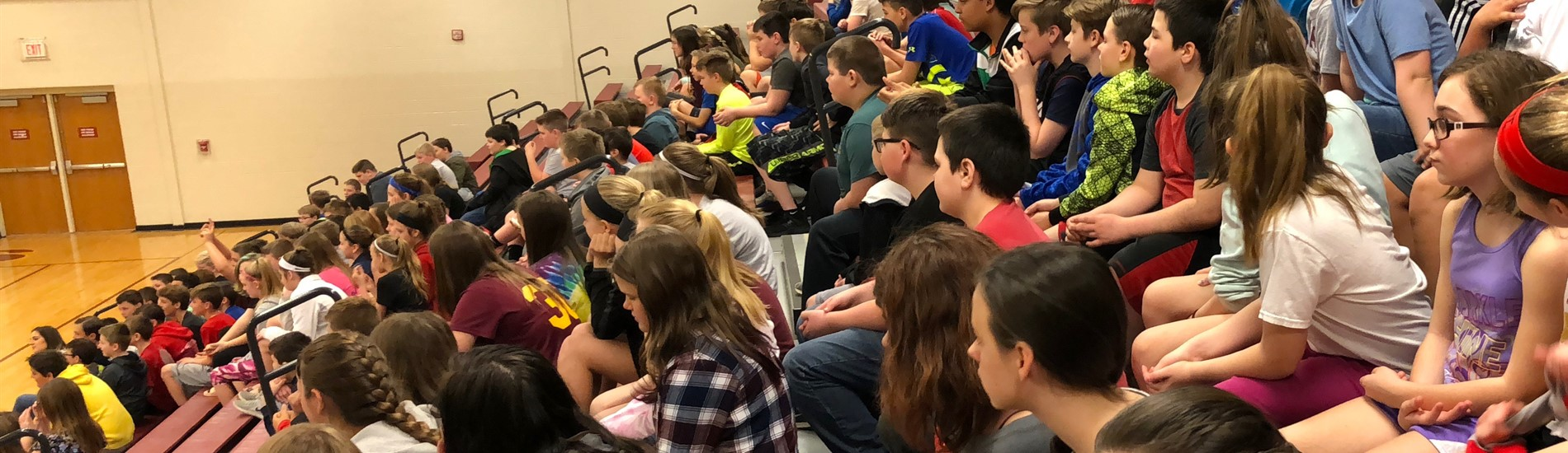 Ross Middle School students watching a dodgeball tournament in the gym.